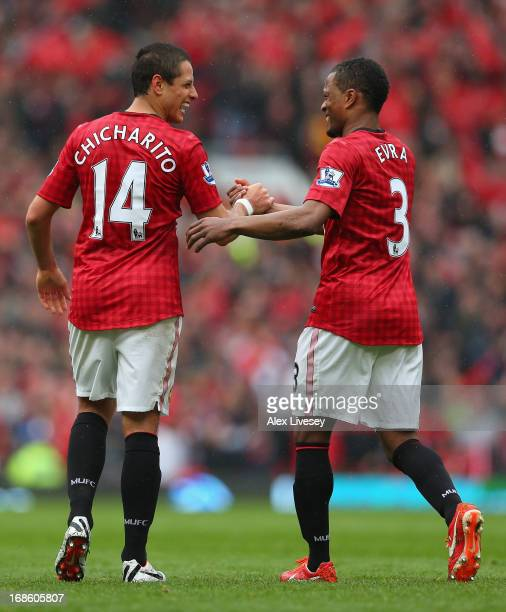 Javier Hernandez of Manchester United is congratulated by teammate Patrice Evra after scoring the opening goal during the Barclays Premier League...