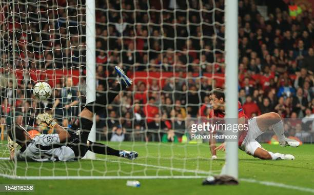 Javier Hernandez of Manchester United scores his team's first goal to make the score 12 during the UEFA Champions League Group H match between...