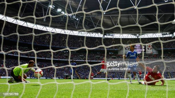 Javier Hernandez of Manchester United scores past Henrique Hilario of Chelsea during the FA Community Shield match between Chelsea and Manchester...