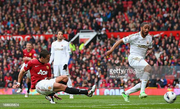 Javier Hernandez of Manchester United scores the opening goal during the Barclays Premier League match between Manchester United and Swansea City at...