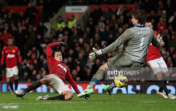 Javier Hernandez of Manchester United scores the winning goal past Tim Krul of Newcastle United during the Barclays Premier League match between...