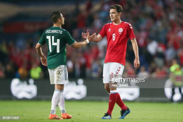 Javier Hernandez of Mexico and Andreas Christensen of Denmark shake hands after the international friendly match between Denmark and Mexico ahead of...