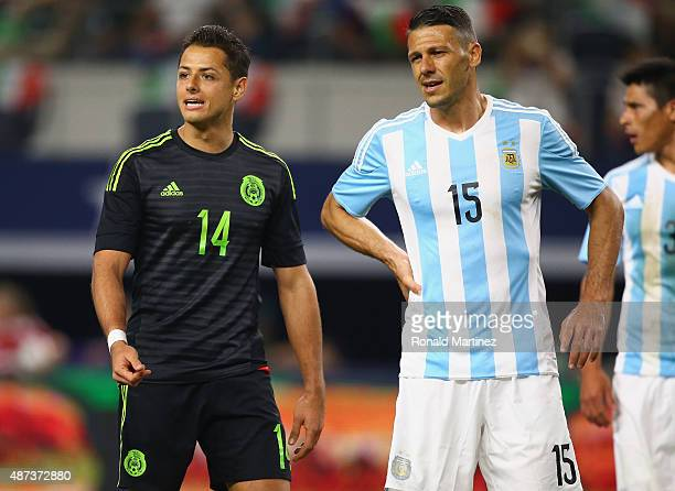 Javier Hernandez of Mexico and Martin Demichelis of Argentina during a international friendly at ATT Stadium on September 8 2015 in Arlington Texas