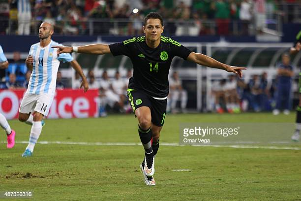 Javier Hernandez of Mexico celebrates after scoring the firs goal of his team during a friendly match between Argentina and Mexico at ATT Stadium on...