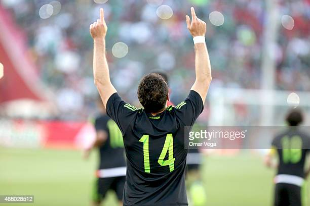 Javier Hernandez of Mexico celebrates after scoring the first goal of his team during a friendly match between Mexico and Ecuador at Memorial...