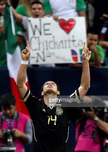 Javier Hernandez of Mexico celebrates his goal in the first overtime period against Honduras at Reliant Stadium on June 22 2011 in Houston Texas...