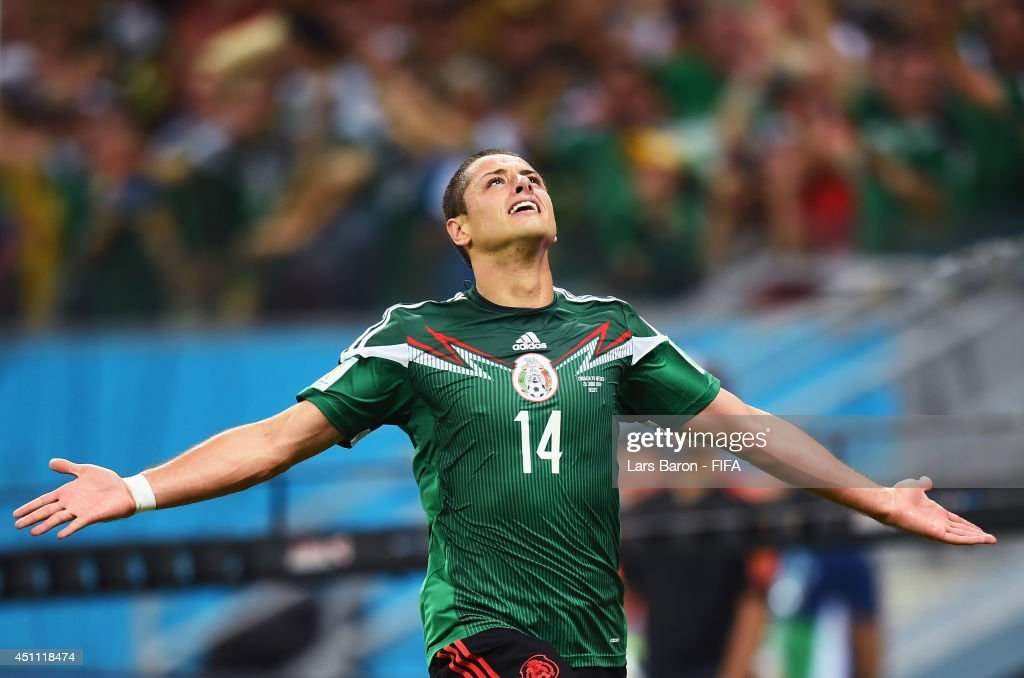 Javier Hernandez of Mexico celebrates scoring his team's third goal during the 2014 FIFA World Cup Brazil Group A match between Croatia and Mexico at Arena Pernambuco on June 23, 2014 in Recife, Brazil.