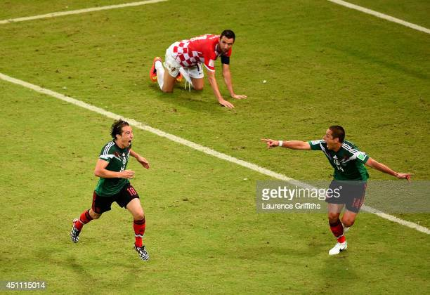 Javier Hernandez of Mexico celebrates their second team goal scored by Andres Guardado during the 2014 FIFA World Cup Brazil Group A match between...