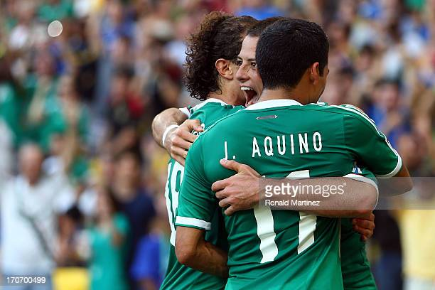 Javier Hernandez of Mexico celebrates with his teammates after scoring his team's first goal from a penalty kick to make the score 11 during the FIFA...