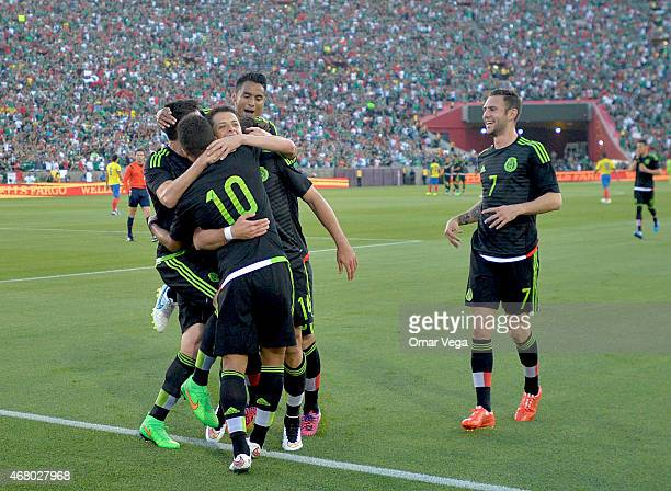 Javier Hernandez of Mexico celebrates with his teammates after scoring the first goal of his team during a friendly match between Mexico and Ecuador...