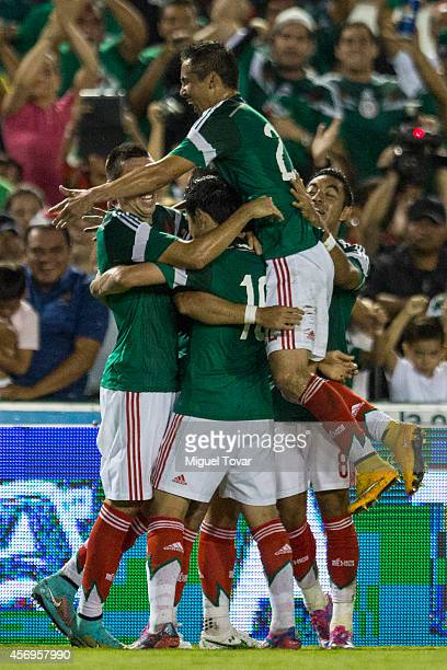 Javier Hernandez of Mexico celebrates with teammates after scoring during a friendly match between Mexico and Honduras at Victor Manuel Reyna Stadium...