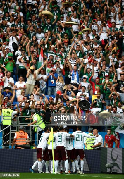 Javier Hernandez of Mexico celebrates with teammates infront of the Mexico fans after scoring his team's second goal during the 2018 FIFA World Cup...