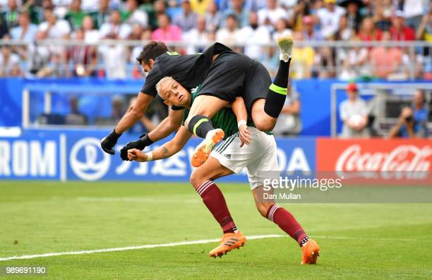 Javier Hernandez of Mexico collides with Alisson of Brazil as they compete for the ball during the 2018 FIFA World Cup Russia Round of 16 match...