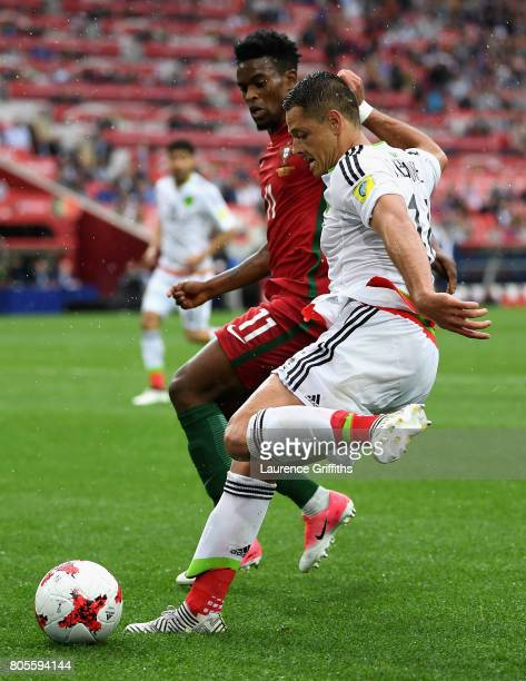 Javier Hernandez of Mexico crosses the ball and it is later turned in by Luis Neto of Portugal for a own goal during the FIFA Confederations Cup...
