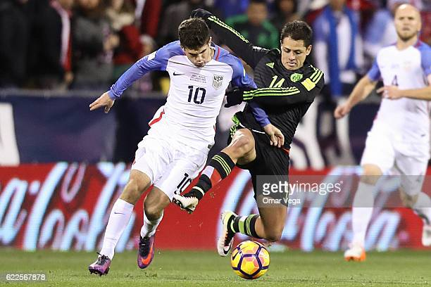 Javier Hernandez of Mexico fights for the ball with Christian Pulisic of USA during the match between USA and Mexico as part of FIFA 2018 World Cup...