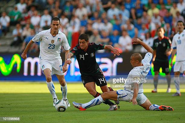 Javier Hernandez of Mexico fights for the ball with Fabio Cannavaro and Leonardo Bonucci of Italy during an International Friendly Match as a...