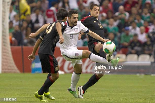 Javier Hernandez of Mexico fights for the ball with Hercules Gomez of the United States during a match between Mexico and US as part of FIFA 2014...