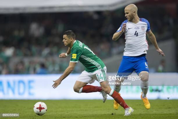 Javier Hernandez of Mexico fights for the ball with Michael Bradley of United States during the match between Mexico and United States as part of the...