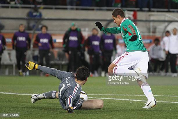 Javier Hernandez of Mexico goes around Hugo Lloris of France and scores the opening goal during the 2010 FIFA World Cup South Africa Group A match...