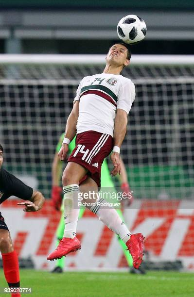 Javier Hernandez of Mexico heads the ball away from Croatia in an intetnational friendly soccet match at ATT Stadium on March 27 2018 in Arlington...