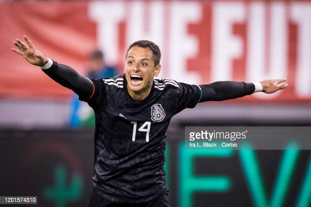 Javier Hernandez of Mexico holds his arms outstretched to celebrate a goal during the second half of the Friendly match between the United States...