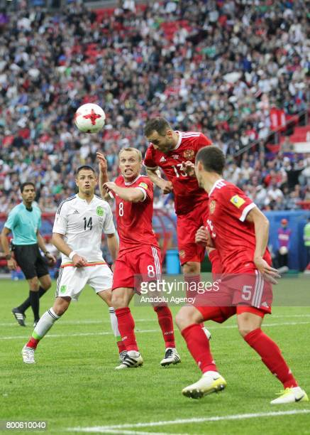 Javier Hernandez of Mexico in action against Denis Glushakov Fedor Kudriashov and Viktor Vasin of Russia during the FIFA Confederations Cup 2017...