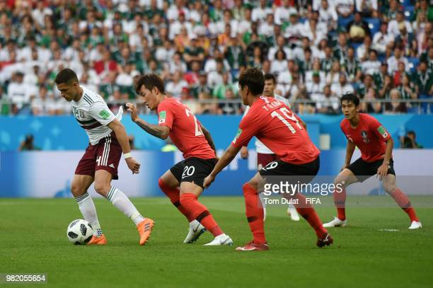 Javier Hernandez of Mexico is challenged by Jang HyunSoo and Kim YoungGwon of Korea Republic during the 2018 FIFA World Cup Russia group F match...