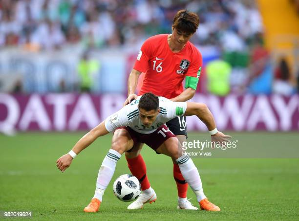 Javier Hernandez of Mexico is challenged by Ki SungYueng of Korea Republic during the 2018 FIFA World Cup Russia group F match between Korea Republic...