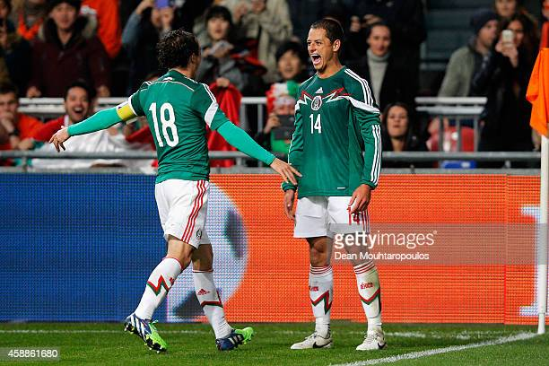 Javier Hernandez of Mexico is congratulated by team mates after scoring the third goal of the game for his team during the international friendly...