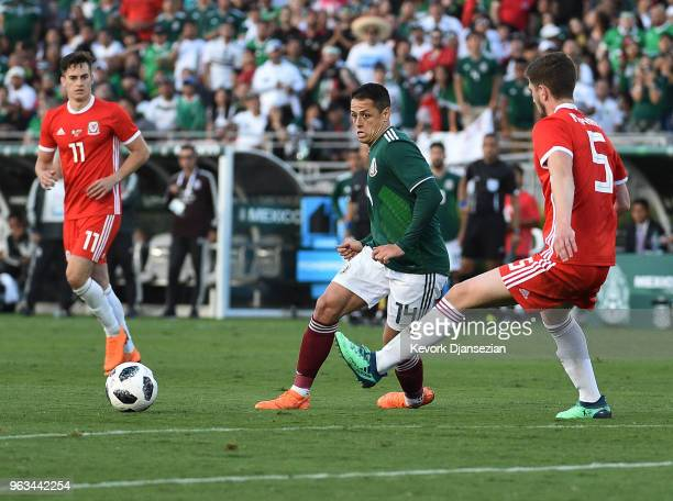Javier Hernandez of Mexico is defended by Chris Mepham of Wales during the first half of their friendly international soccer match at the Rose Bowl...