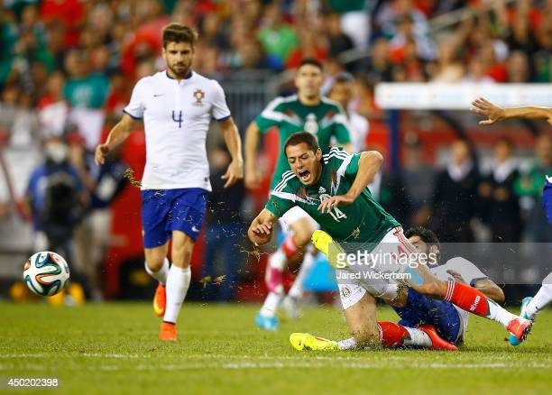 Javier Hernandez of Mexico is fouled by Neto of Portugal in the second half during the international friendly match at Gillette Stadium on June 6...