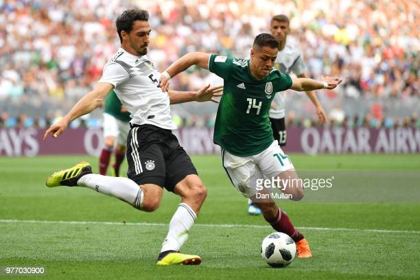 Javier Hernandez of Mexico is tackled by Mats Hummels of Germany during the 2018 FIFA World Cup Russia group F match between Germany and Mexico at...