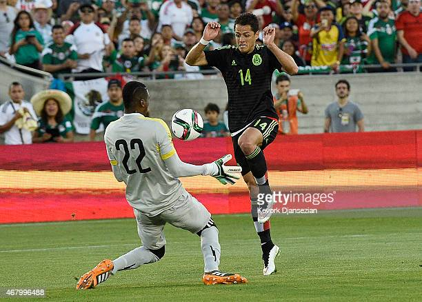 Javier Hernandez of Mexico jumps over goalkeeper Alexander Dominguez of Ecuador during the International Friendly match between Mexico and Ecuador at...