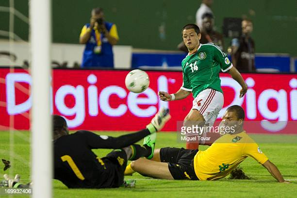 Javier Hernandez of Mexico kicks the ball during a match between Mexico and Jamaica as part of the FIFA 2014 World Cup Qualifiers at the National...