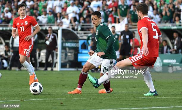 Javier Hernandez of Mexico looks to control the ball against Chris Mepham of Wales during the second half of their friendly international soccer at...