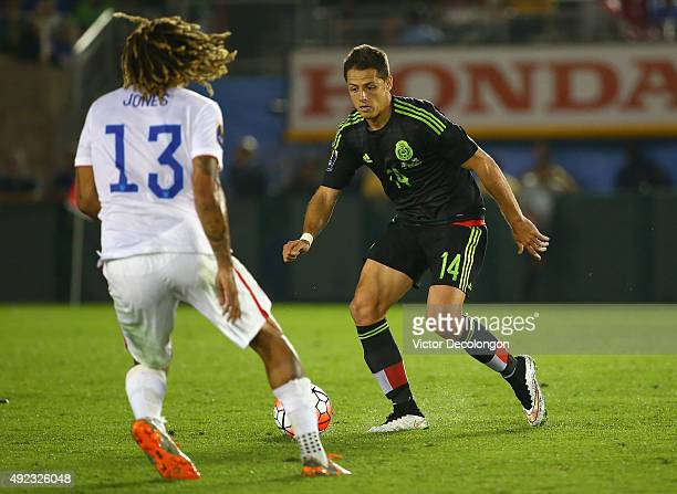 Javier Hernandez of Mexico looks to make a play against Jermaine Jones of the United States during the 2017 FIFA Confederations Cup Qualifying match...