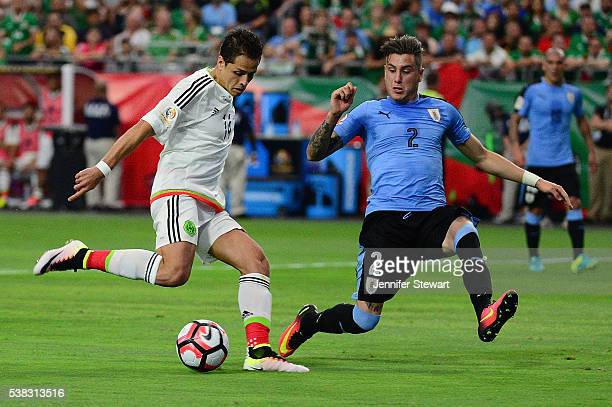 Javier Hernandez of Mexico moves the ball against Jose Gimenez of Uruguay during the 2016 Copa America Centenario Group C match at University of...