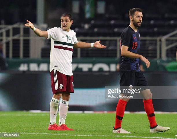 Javier Hernandez of Mexico reacts to the referee after a play during an international friendly soccer match against Croatia at ATT Stadium on March...