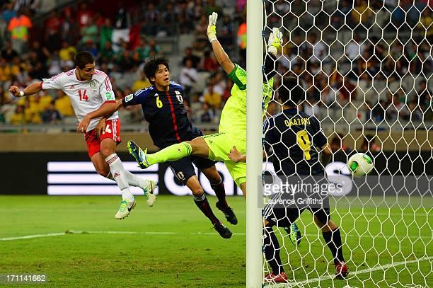 Javier Hernandez of Mexico scores a goal past Eiji Kawashima Atsuto Uchida and Shinji Okazaki of Japan during the FIFA Confederations Cup Brazil 2013...