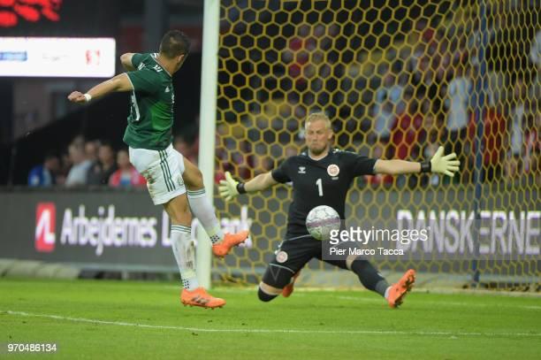 Javier Hernandez of Mexico shoots the ball against goalkeeper Kasper Schmeichel of Denmark during International Friendly match between Denmark v...