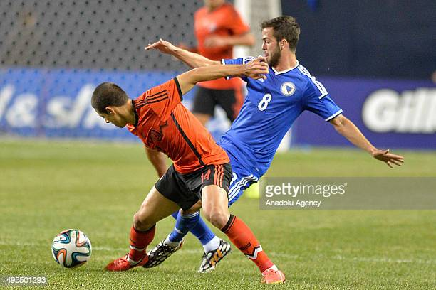 Javier Hernandez of Mexico struggles for the ball with Miralem Pjanic of Bosnia during a friendly match at the Soldier Field in Chicago United States...