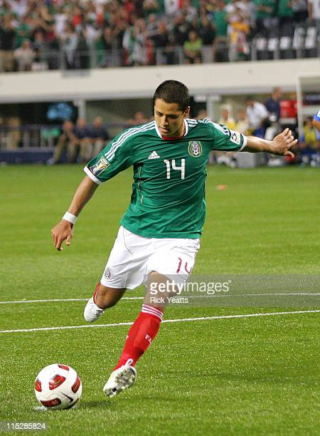 Javier Hernandez of Mexico takes a a penalty kick and scores against El Salvador during the CONCACAF Gold Cup qualifying match at Cowboys Stadium on...