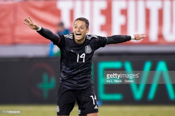 Javier Hernandez of Mexico throws his arms out as he celebrates the goal by Erick Gutierrez of Mexico during the 2nd half of the Friendly match...