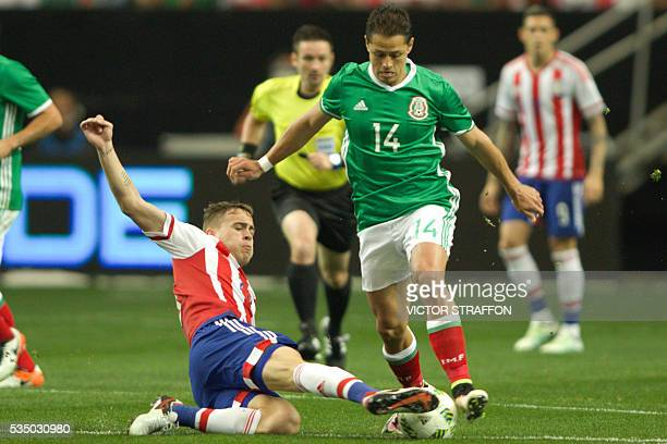 Javier Hernandez of Mexico vies for the ball with Robert Andres of Paraguay during the friendly match between the Mexican national team and Paraguay...