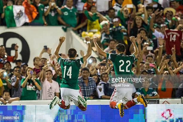 Javier Hernandez of Mexico with Paul Aguilar after scoring during a friendly match between Mexico and Honduras at Victor Manuel Reyna Stadium on...