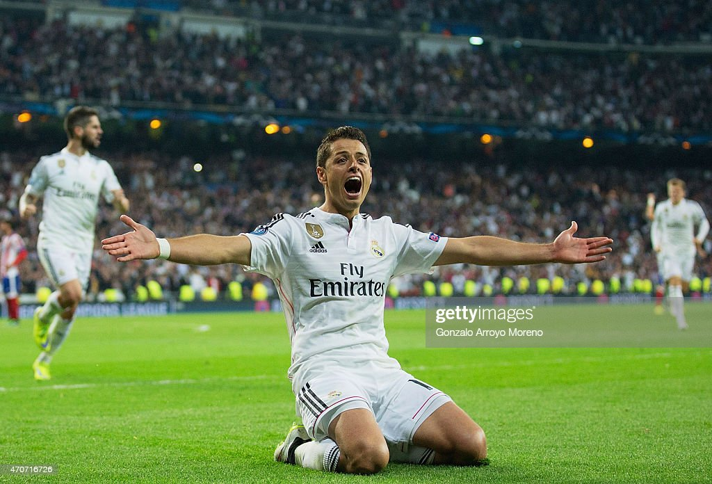 Javier Hernandez of Real Madrid CF celebrates as he scores their first goal during the UEFA Champions League quarter-final second leg match between Real Madrid CF and Club Atletico de Madrid at Bernabeu on April 22, 2015 in Madrid, Spain.