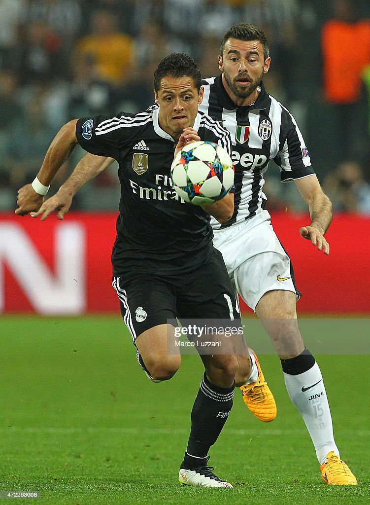 Javier Hernandez of Real Madrid CF competes for the ball with Andrea Barzagli of Juventus FC during the UEFA Champions League semi final match between Juventus and Real Madrid CF at Juventus Arena on May 5, 2015 in Turin, Italy.