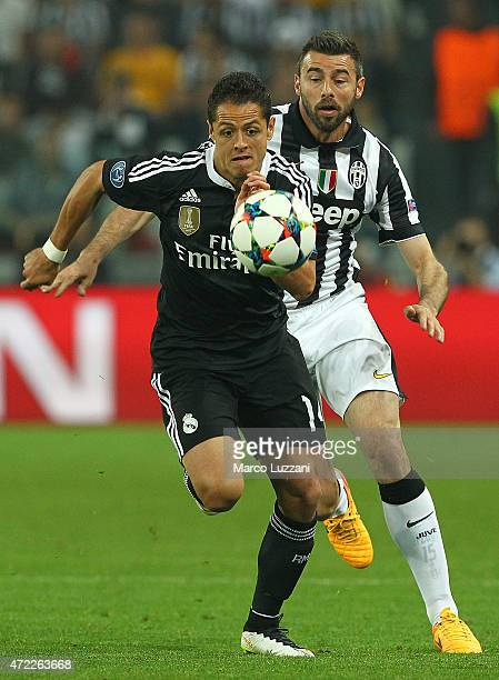 Javier Hernandez of Real Madrid CF competes for the ball with Andrea Barzagli of Juventus FC during the UEFA Champions League semi final match...