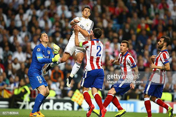 Javier Hernandez of Real Madrid jumps to head the ball under pressure from Jan Oblak and Diego Godin of Atletico de Madrid during the UEFA Champions...
