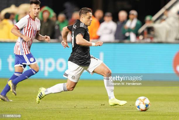 Javier Hernandez of the Mexico National team dribbles the ball up field against Paraguay during the second half of their soccer game at Levi's...
